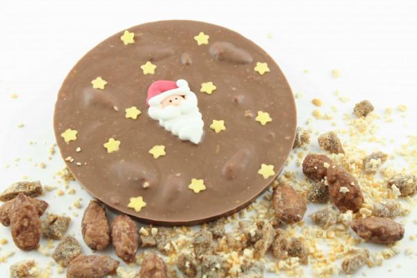 Vollmilchschokolade mit gebranten Mandeln, geraspeltem Nougat und Feigenstückchen