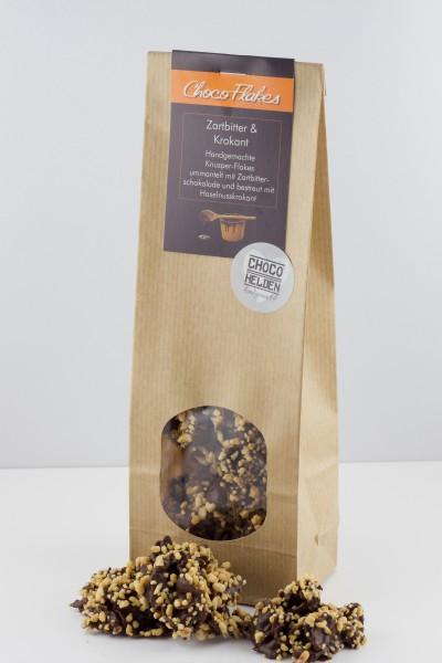 Knackige Cornflakes kombiniert mit unserer Edel-Zartbitter-Schokolade und nussiig-süßem Krokant.