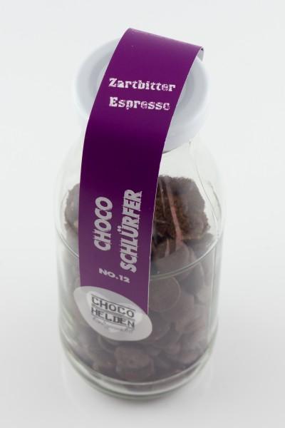 Cremig - herbe Trinkschokolade mit Zartbitter und gemahlenen Espressobohnen.